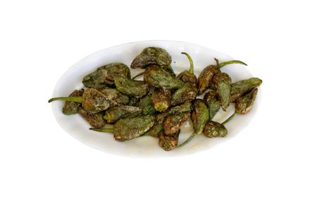 a small tray of fried green peppers Stock Photo