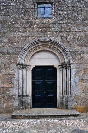 unyielding: a church closed door with a window in the top Stock Photo