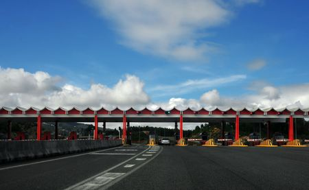 landscape view of a highway toll with cars passin trhough