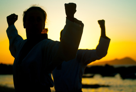 martial arts training on the beach at the afternoon Stock Photo