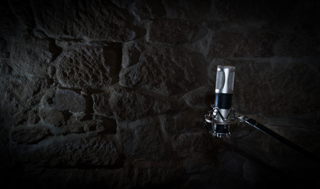 old audio microphone in a stone studio recording