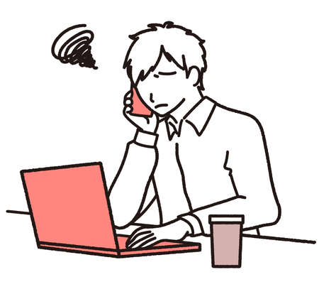 Troubled looking man on laptop while calling on mobile phone