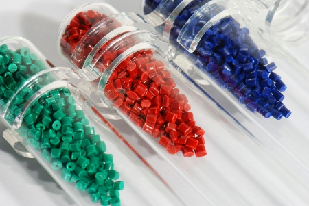 scrutinise: Dyed plastic compound Stock Photo