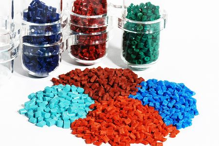 Dyed plastic granulate in test glasses photo