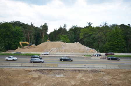 building lot of new bridge over motorway after blasting the old one