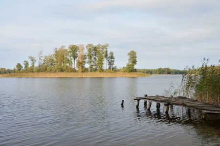 footbridge with isle at lonely lake Stock Photo - 16189998