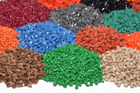 plastic recycling: several dyed polymer resins for injection moulding process