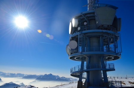 radio tower: Top of mountain Rigi Alp in Switzerland, Europe, in the sunlight at noon in winter with blue sky  Stock Photo