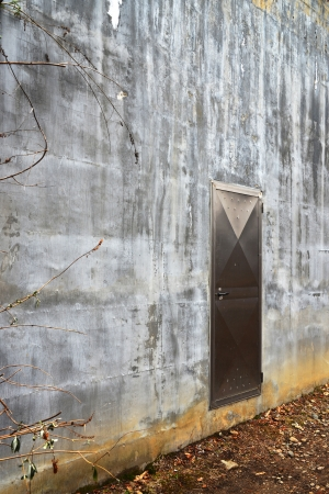 closed stainless steel door in concrete wall photo