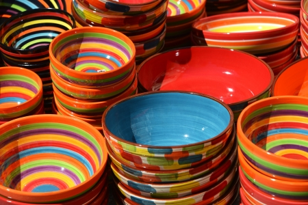 colourfully: Several painted ceramic pots on market in the sun