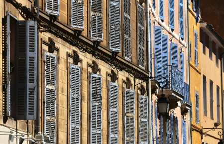 leant: windows with closed shutters in afternoon sun Stock Photo