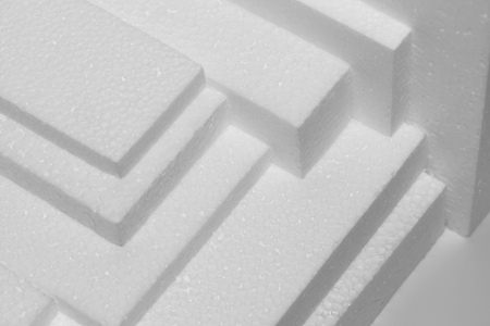 several white polystyrene sheets for damping and packaging