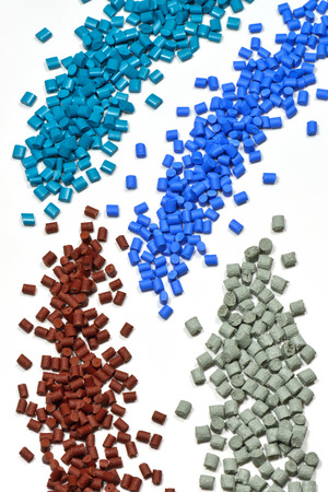 resin: little heap of tinted polymer resin pellets for injection moulding