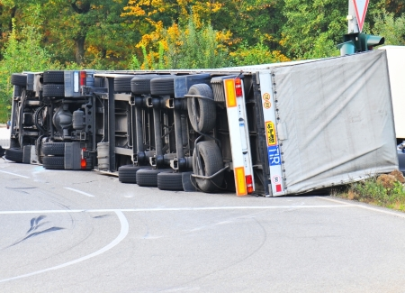 overtired: Truck fell over after accident