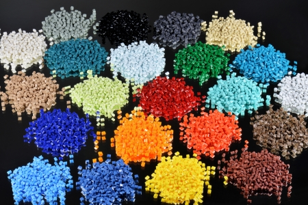 resin: several colored polymer resins on black for injection moulding in laboratory