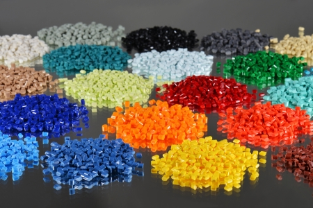 resin: several dyed polymer resins for plastic industry on mirror