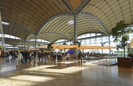 alicante: departure terminal with shops at Alicante Airport in Spain, Europe  Editorial