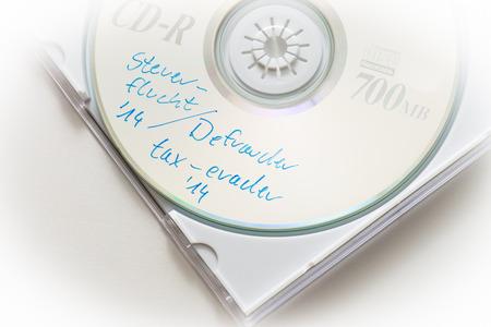 tratados: CD con datos de thousends de los tramposos de impuestos Foto de archivo