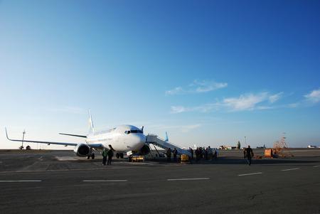 The international Airport of Simferopol, Crimea, Ukraine  With airplane from  Ukraine International  airline awaiting departure