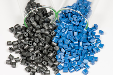 blue and black polymer pellets in test tubes in laboratory photo