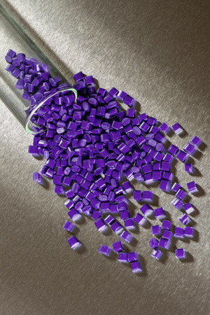 stainless steel sheet: purple polymer granulate on stainless steel sheet in laboratory
