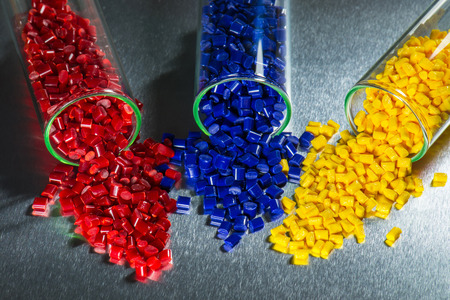 colored dye: blue, red and yellow polymer resin in test glasses on steel sheet