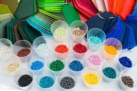 plastics: several dyed plastic polymer granulates in laboratory Stock Photo