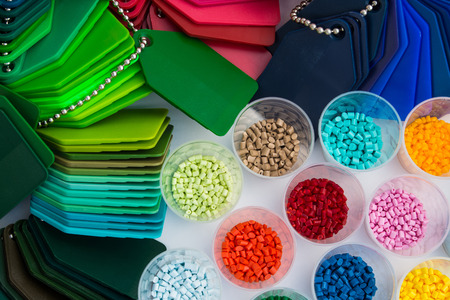 styrene: several dyed plastic polymer granulates in laboratory Stock Photo