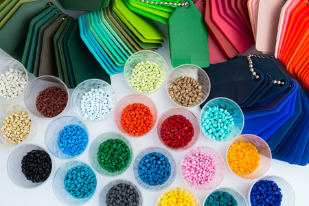 several dyed plastic polymer granulates in laboratory Stock Photo