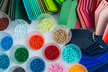 several dyed plastic polymer granulates in laboratory Banque d'images