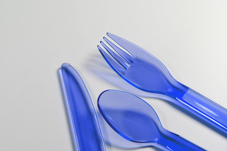 plastic made: blue plastic cutlery made from polypropylene on white background Stock Photo