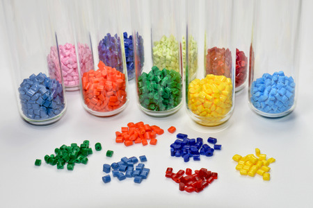 a variation of polymer resins with test tubes in laboratory photo