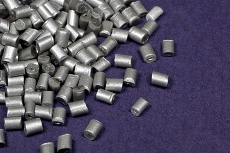 galvanize: silver polymer resin for injection moulding process on violet background