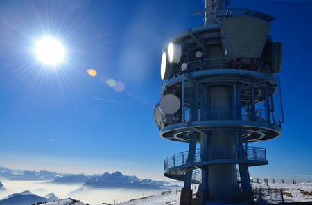 parabolic mirror: Top of mountain Rigi Alp in Switzerland, Europe, in the sunlight at noon in winter with blue sky  Stock Photo