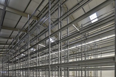 steelwork: new building of high bay stock warhouse with steel shelevs Stock Photo