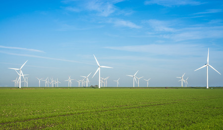onshore: Onshore windmill power plant in northern Germany Stock Photo
