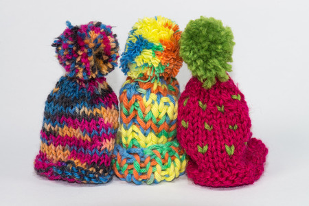 bobble: Three little knitted bobble caps using for egg cozy and warm