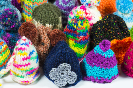 bobble: crowd of knitted bobble caps using for egg cozy and warm Stock Photo