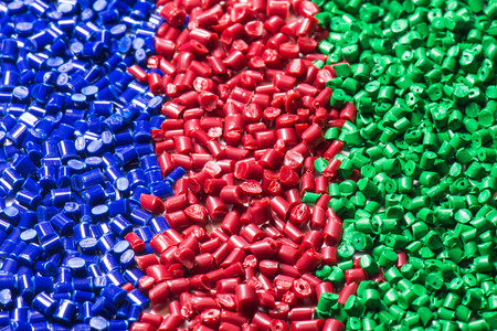 dyeing: blue, green and red polymer pellets for injection molding
