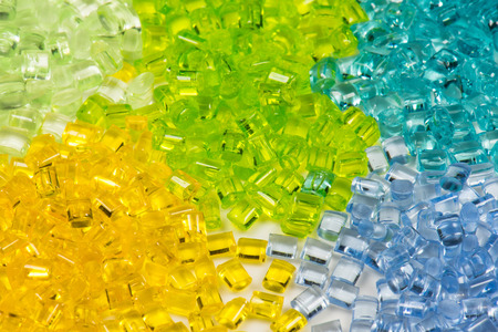 five different translucent polymer pellets for injection molding