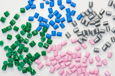 compound: different dyed polymer pellets on white Stock Photo