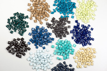 different dyed plastic pellets for injection molding process photo