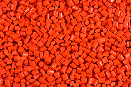 compounding: orange dyed plastic granules for injection molding process