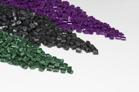 compound: violet, gray and green polymer resin on white table for background Stock Photo