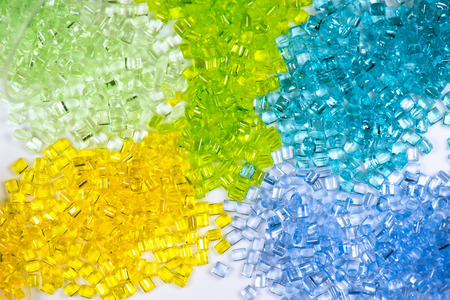rennet: close-up of dyed banner polymer resins in lab on white background Stock Photo