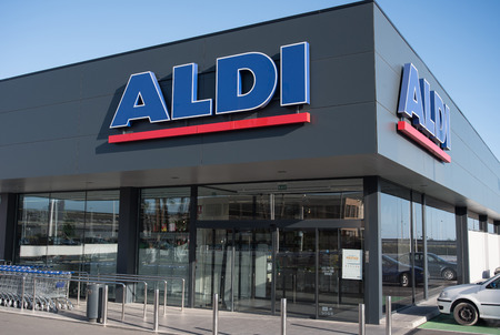 shop opening hours: very new discounter Aldi shop with new symbol and sign in Spain
