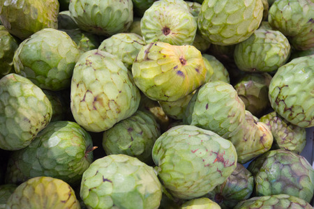 chirimoya: a lot of cherimoyas on market in Spain Stock Photo