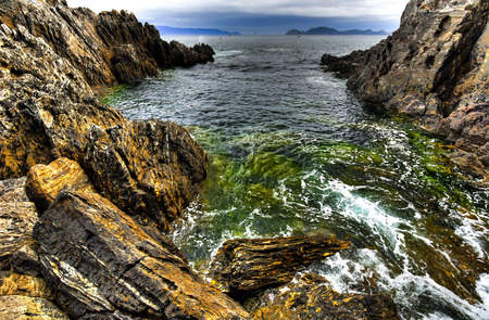 spume: Ocean coast with cliffs and spume in Galicia, Northern-Spain Stock Photo