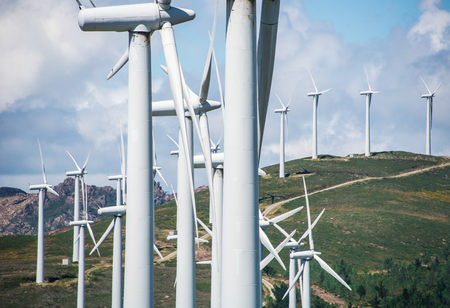 industrial park: windmill-powered plant on Hilltop in Europe