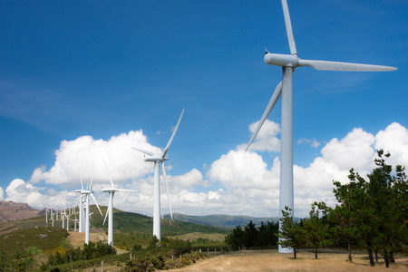 powered: windmill powered plant on Hilltop in Europe Stock Photo